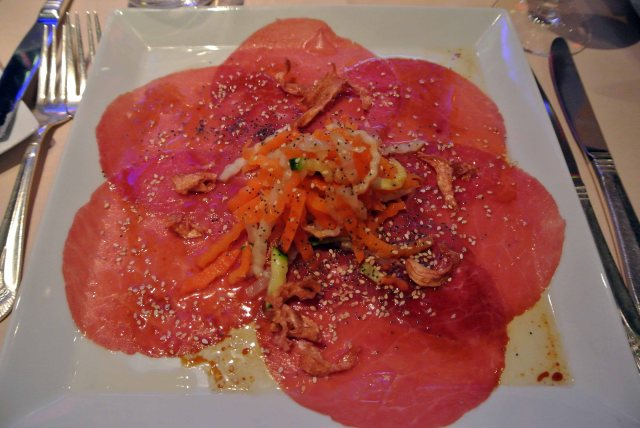 Little Italy beef carpaccio ... Caper berries and crunchy vegetables, olive vinaigrette