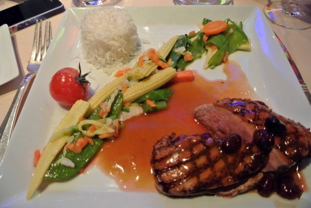 """Brownstone's Duck"""" ... Duck breast with orange, fragrant rice and glazed vegetables"""
